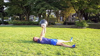 outdoor medicine ball sit-ups - step 1