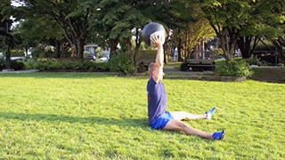 Picture of a male doing Outdoor Medicine Ball Sit-Ups Exercise