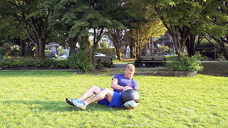 Picture of a male doing Outdoor Medicine Ball Twist Exercise