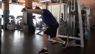 Picture of a male doing Overhead Cable Tricep Extension Exercise