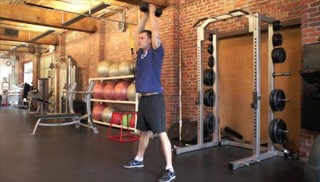 Picture of a male doing Overhead Dumbbell Throw Exercise