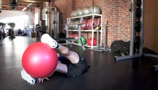 Picture of a male doing Pendulums with the Stability Ball Exercise