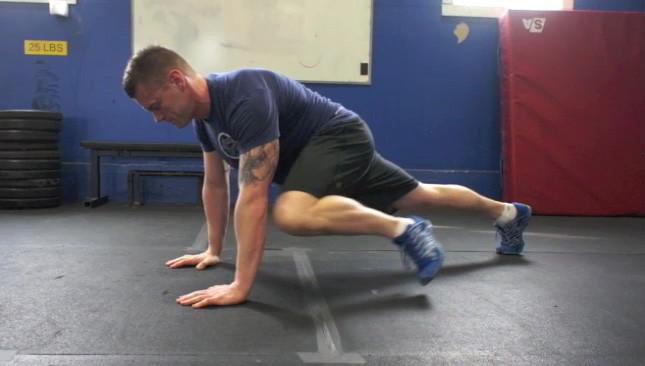 Picture of a male doing Plank Knee to Elbow Exercise