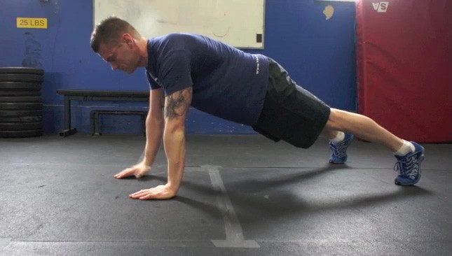 Picture of a male doing Plank to Push Up Exercise