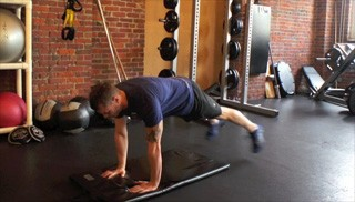 push up plank toe taps - step 1