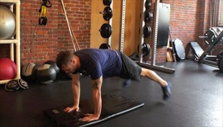 push up plank toe taps - step 3