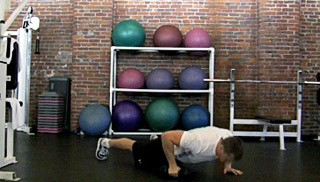 Picture of a male doing Push-Up with Dumbbell Twist Exercise