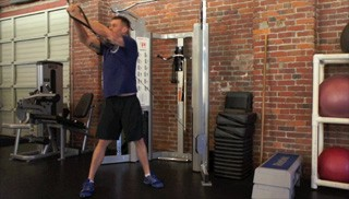 Picture of a male doing Reverse Cable Woodchops Exercise