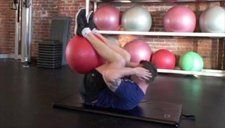 Picture of a male doing Reverse Crunch  Exercise