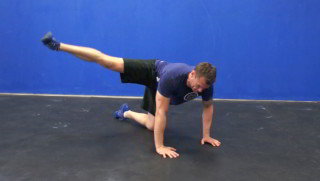 Picture of a male doing Side Glute Kick Outs Exercise
