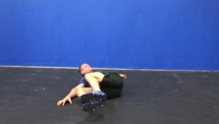 Picture of a male doing Side Knee Drops Exercise
