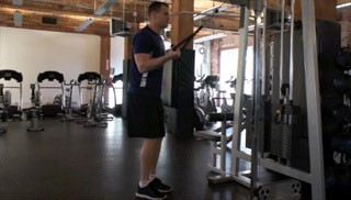single arm cable tricep extension - step 1