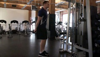 Picture of a male doing Single Arm Cable Tricep Extension Exercise