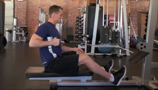 Picture of a male doing Single Arm Seated Row Exercise