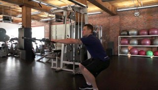 Picture of a male doing Single Arm Squat Row Exercise
