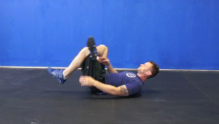 Picture of a male doing Single Leg Glute Stretch Exercise