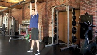 Picture of a male doing Squat Press w/ Weight Plate Exercise