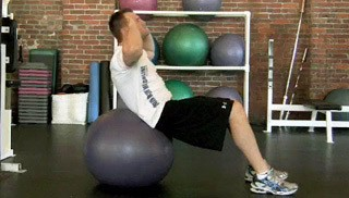Picture of a male doing Stability Ball Ab Crunch Exercise