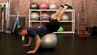 Picture of a male doing Stability Ball Dolphin Exercise