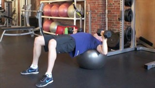 Picture of a male doing Stability Ball Dumbbell Press Exercise