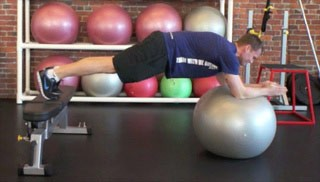 Picture of a male doing Stability Ball Push-Outs on the Bench Exercise