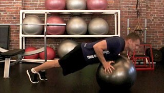 Picture of a male doing Stability Ball Push-Ups Exercise