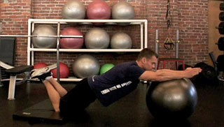 Picture of a male doing Stability Ball Roll Outs Exercise