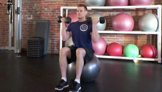 Picture of a male doing Stability Ball Seated Bicep Curl Exercise
