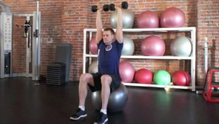 Picture of a male doing Stability Ball Shoulder Press Exercise