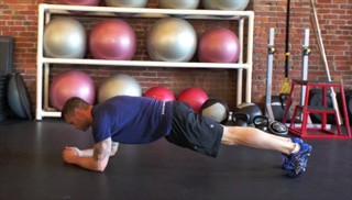 Picture of a male doing The Plank Exercise