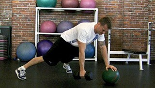 three point dumbbell row on medicine ball - step 1