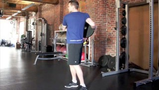 Picture of a male doing Trunk Twist w/ Weight Plate Exercise