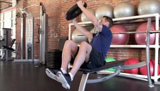 Picture of a male doing Trunk Twist with Press on Bench Exercise