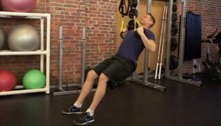 Picture of a male doing TRX Seated Pull-Up Exercise