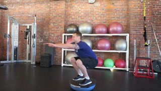 Picture of a male doing Upside-Down Bosu Squat  Exercise