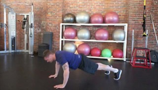 Picture of a male doing Walk-Out Push-Up Exercise
