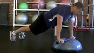 weighted bar push-up knee tuck - step 1