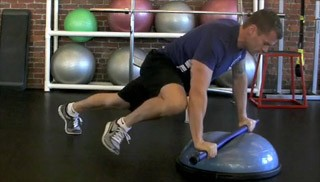 weighted bar push-up knee tuck - step 3